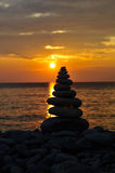 Zen sunset. Render of Stacked Zen Stones Against Sunset Stock Photo