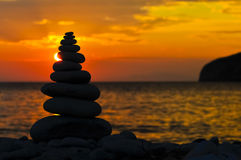 Zen sunset. Render of Stacked Zen Stones Against Sunset Royalty Free Stock Photography