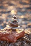 Zen Tower on Beach in Shape of Xmas Tree isolated on christmas sparkle bokeh background Stock Photo