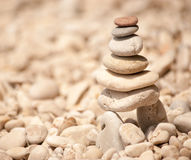 Zen tower of stacked pebbes on stilts, square image Royalty Free Stock Image