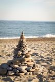 Zen tower of stones on the beach. Homemade zen tower of stones on the beach Royalty Free Stock Photography