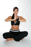 Zen woman. Gym woman doing stretching exercise at the gym with a zen attitude royalty free stock images