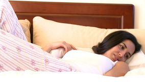 Zen woman lying on bed stock footage