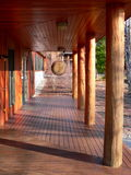 Zen: wooden walkway with disc gong Royalty Free Stock Images