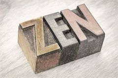 Zen word abstract in wood type. Zen - word abstract in vintage wooden letterpress printing blocks, digital painting filter applied to a photograph stock photography