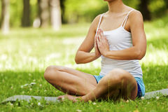 Zen yoga position woman on the grass. Royalty Free Stock Photo