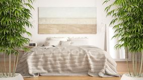 Zeninre med den inlagda bambuväxten, naturligt inredesignbegrepp, klassiskt sovrum, scandinavian modern stil, minimalistic a royaltyfri fotografi