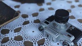 Zenit för tappningfotokamera på tabellen lager videofilmer