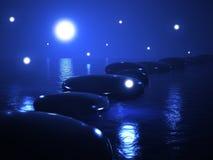 Zensteine im Wasser, magische Nacht Stockfotografie