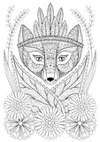 Zentangle wild fox with indian war bonnet in grass and flowers. Royalty Free Stock Image