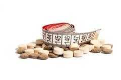 Zentimeter und Drogen für Gewichtverlust Lizenzfreies Stockbild