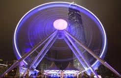 Zentrale Hong Kong-Nachtansicht mit neuem Riesenrad Stockfotografie