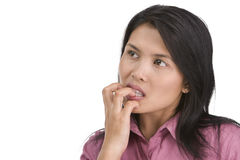 Zenuwachtig en bijtend haar vingernagel stock afbeeldingen