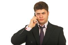 Zenuwachtige bedrijfs mobiele mens telefonisch royalty-vrije stock foto's