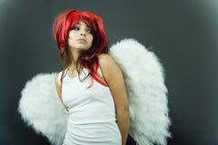 Zenuwachtige Roodharige met Vleugels Stock Fotografie
