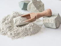 Zeolite raw powder and stones on white background stock photos