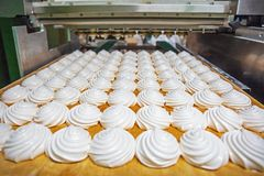 Zephyr and marshmallows production line machine, food industry and bakery. Close up royalty free stock images
