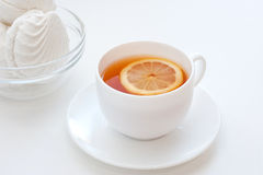 Zephyr och tea med en citron Arkivbilder