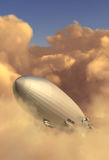 Zeppelin. Modeled after the Hindenburg emerging from a cloud bank in the late afternoon Royalty Free Stock Photos