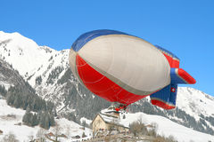 Zeppelin at Chateau d'Oex. Sorrounded by mountains, the valley where Chateau D\'Oex is guests the 28\' Hot Air Baloon Festival. Here is the only zeppelin Stock Photos