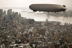 Zeppelin over Manhattan. Manhattan A big Zeppelin flies over Manhattan, in an image reminding the existant ones of the first decades of the twentieth century Stock Image