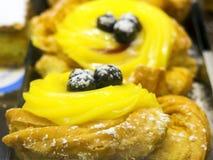 Zeppola yellow cream and black cherry Royalty Free Stock Photography