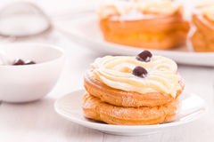 Zeppole with pastry cream. Zeppole with pastry cream on white dish Royalty Free Stock Photo