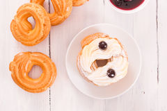 Zeppole with pastry cream. Royalty Free Stock Image