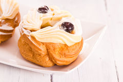 Zeppole with pastry cream. Royalty Free Stock Photo