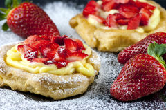 Zeppole with strawberry- tipical italian pastry Stock Images