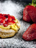 Zeppole with strawberry- tipical italian pastry Stock Photos