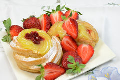 Zeppole with strawberries Stock Image