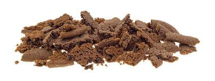 Zerfallene niederländische Kakaoplätzchen auf einem weißen Hintergrund Lizenzfreie Stockbilder