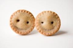 Zerkleinern Sie Torten (sind sie lächelnd?) Stockfotografie