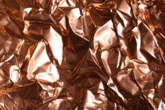 Zerknittert stieg Goldfolie als Hintergrund stockbilder
