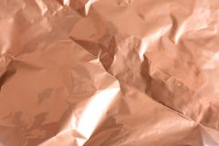 Zerknittert stieg Goldpapier als Hintergrund stockfoto
