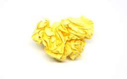 Zerknitterter gelber Papierball Stockfotos