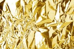 Zerknitterter glänzender Beschaffenheitshintergrund der goldenen Folie, helles glänzendes Goldluxusentwurf, metallische Funkelnob stockfotografie