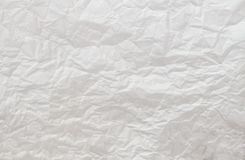 Zerknitterter Weißbuch-Hintergrund Stockfotografie