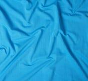 Zerknittertes Baumwollgewebe der blauen Farbe lizenzfreie stockfotos