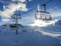 Zermatt ski lift. With the sun shining in the background royalty free stock photography
