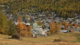 Zermatt surrounded by colorful forests royalty free stock image
