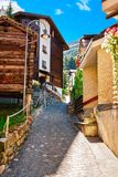 Zermatt, Switzerland - August 24, 2016: Narrow Street at center of Zermatt, Valais, Switzerland in summer. Zermatt, Switzerland - August 24, 2016: Narrow Street stock photos
