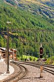 Zermatt, Switzerland - August 24, 2016: Railway train station and landscape in Zermatt Valais in Switzerland. Zermatt, Switzerland - August 24, 2016: Railway stock images