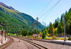 Zermatt, Switzerland - August 24, 2016: Railway train station and landscape in Zermatt, Valais, Switzerland. Zermatt, Switzerland - August 24, 2016: Railway royalty free stock photo