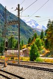 Zermatt, Switzerland - August 24, 2016: Railway train station and landscape in Zermatt, Valais in Swiss. Zermatt, Switzerland - August 24, 2016: Railway train stock photography