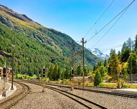 Zermatt, Switzerland - August 24, 2016: Railway train station in Zermatt, Valais canton, Switzerland. Zermatt, Switzerland - August 24, 2016: Railway train stock images