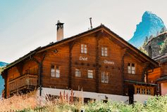 Zermatt, Switzerland - 24 August, 2016: Traditional Swiss Chalet at Zermatt with Matterhorn summit, Switzerland in summer. Zermatt, Switzerland - 24 August, 2016 stock images