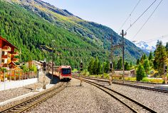 Zermatt, Switzerland - August 24, 2016: Train at Railway station in Zermatt, Valais canton, Switzerland. Zermatt, Switzerland - August 24, 2016: Train at Railway stock image
