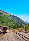 Zermatt, Switzerland - August 24, 2016: Train at Railway station in Zermatt, Valais canton, in Switzerland. Zermatt, Switzerland - August 24, 2016: Train at royalty free stock photo